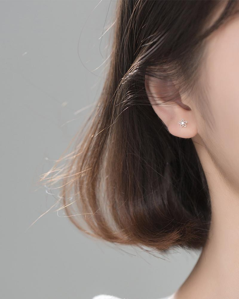 shop sukoshi Flower Wire Mini Stud Earrings in silver on model sterling jewelry collection