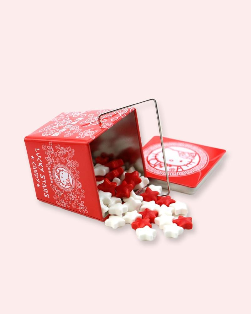 Hello Kitty Lucky Stars Candy Tin with candy spilling out