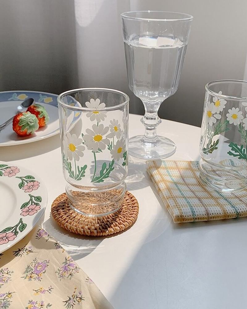 Shop Hotzilla Daisy Glass Cup shown with coaster and plates