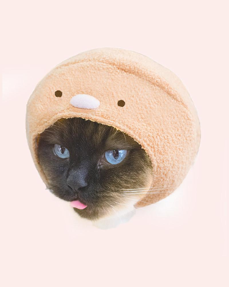 Cat is wearing a tonkatsu cap (character based off fried pork)