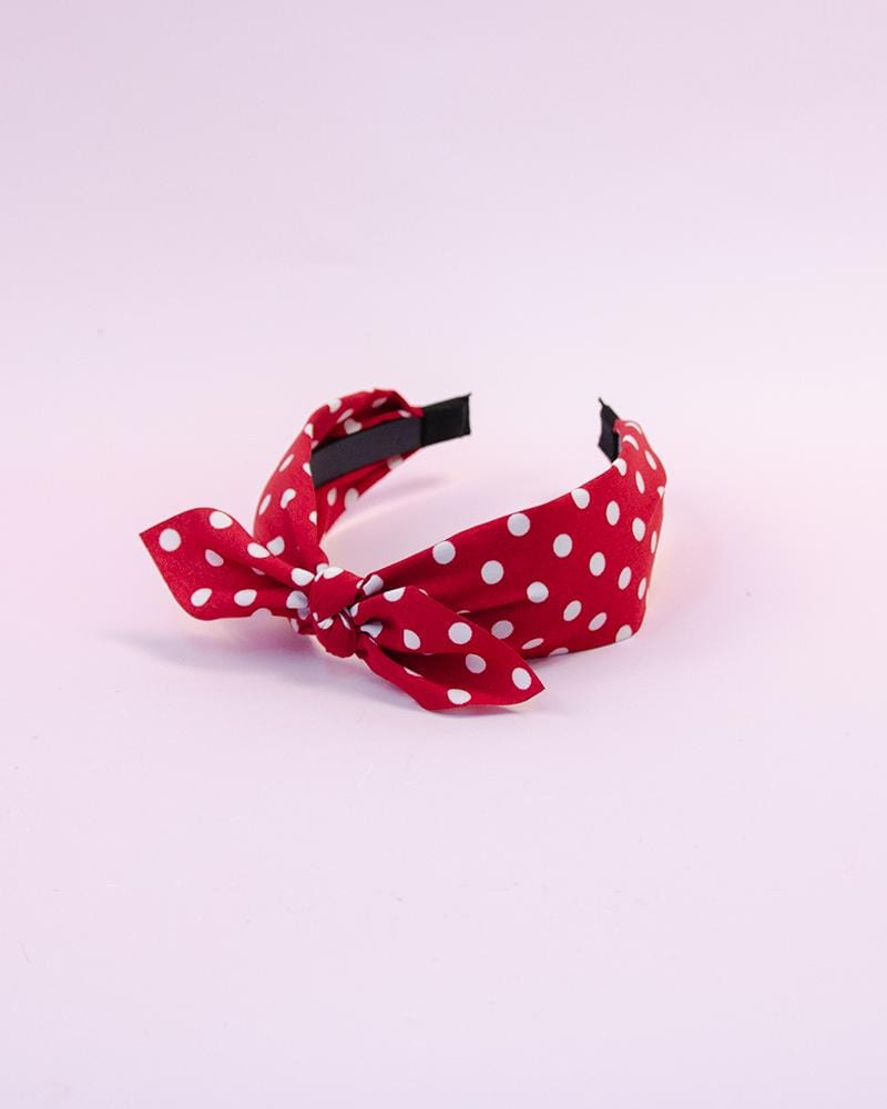 spotted bow headband in red colour style, displayed on tote bag