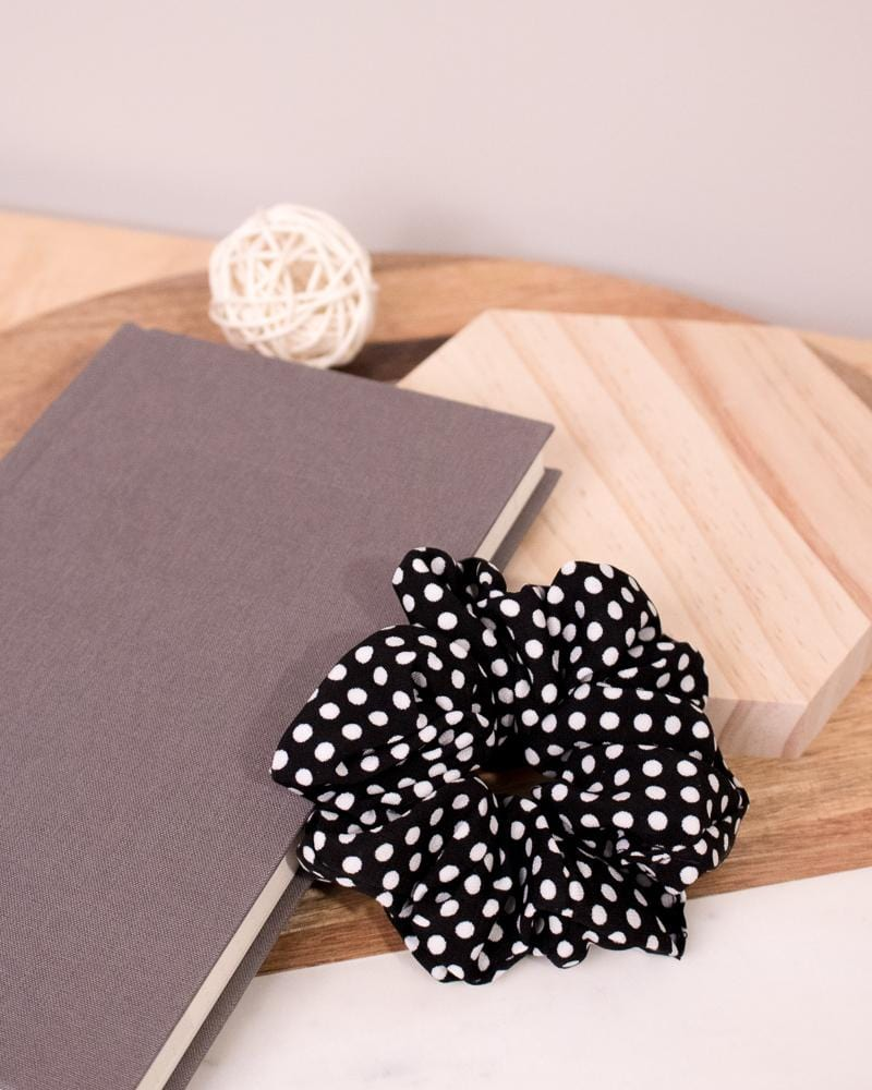 Polka Dotted Scrunchie in Black colour style displayed on notebook