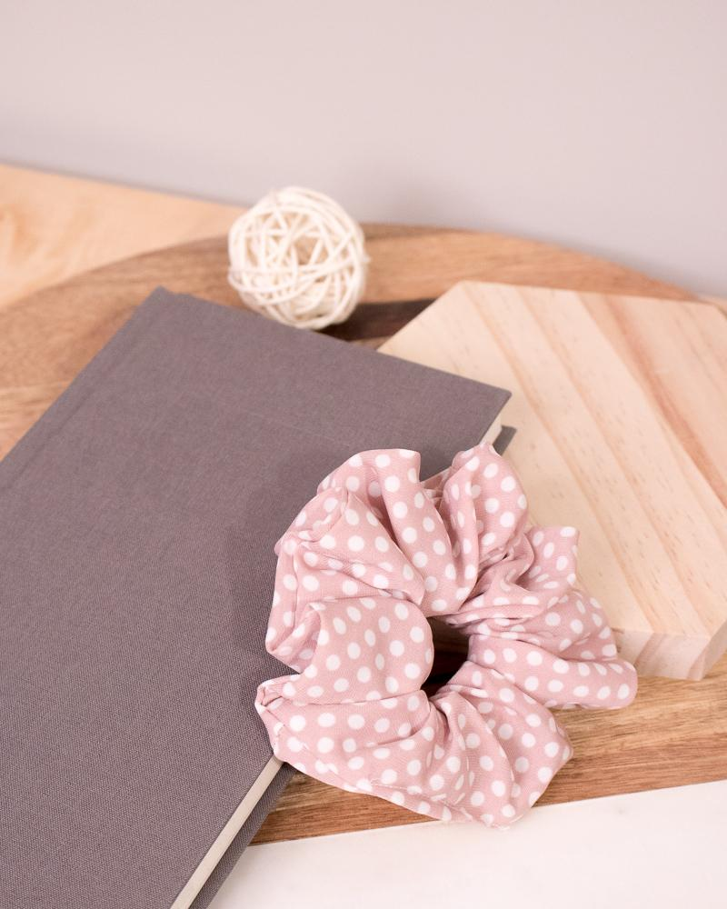 Polka Dotted Scrunchie in dusty pink colour style displayed on notebook