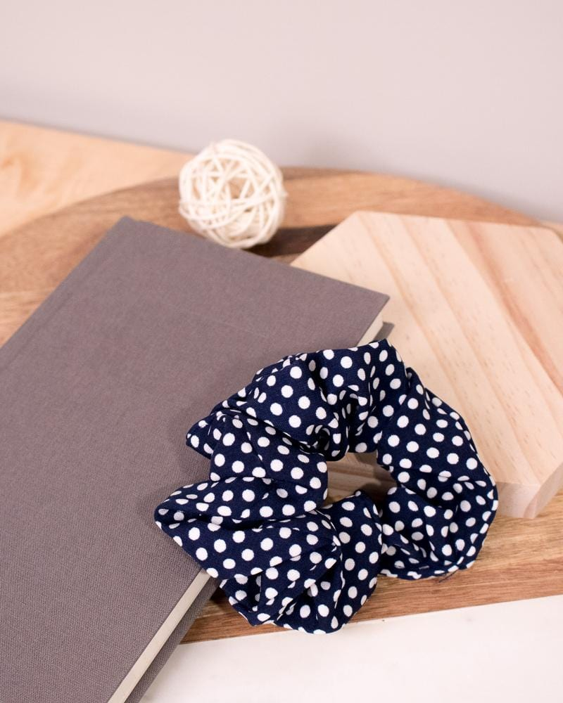 Polka Dotted Scrunchie in navy colour style displayed on notebook