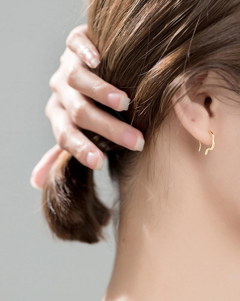 shop sukoshi Side Profile Hook Earrings silver and gold sterling jewelry collection on model