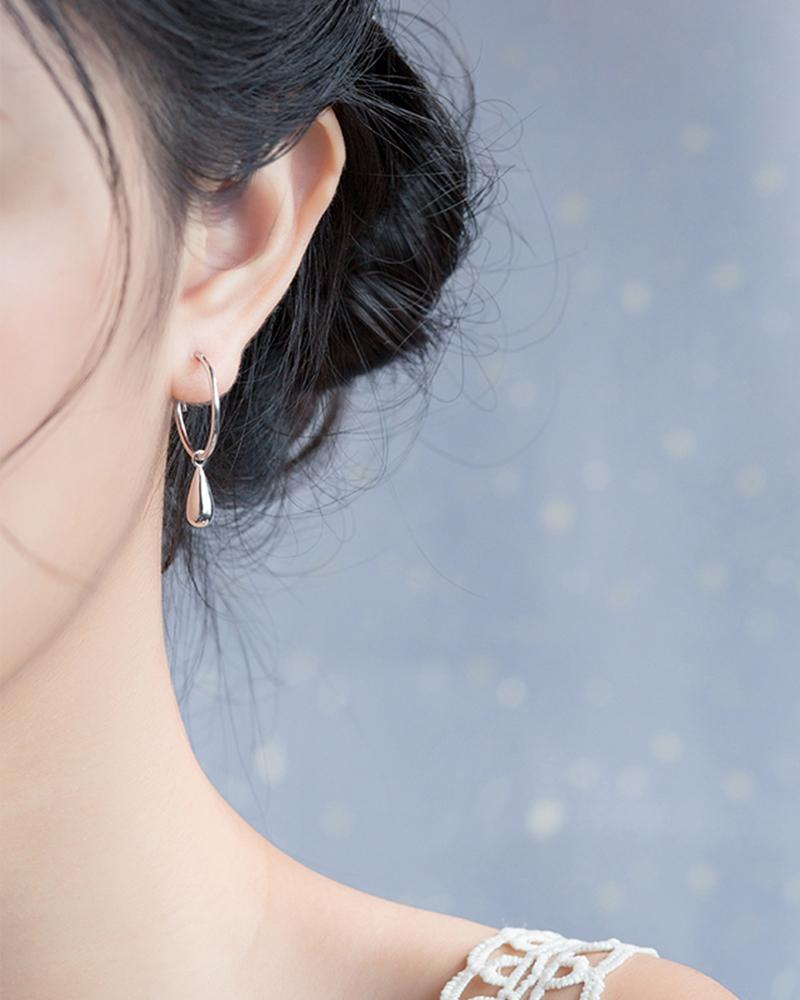 Shop sukoshi Single Teardrop Hoop Earrings silver sterling jewelry collection on model