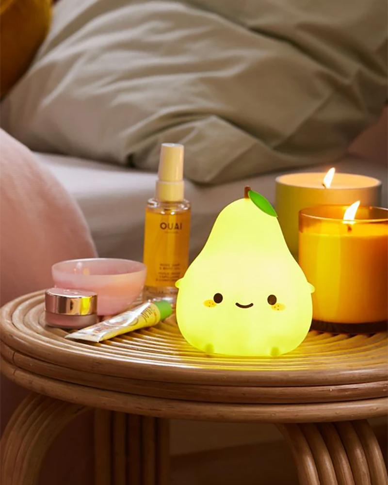 Smoko Lulu the green pear sitting on nightstand