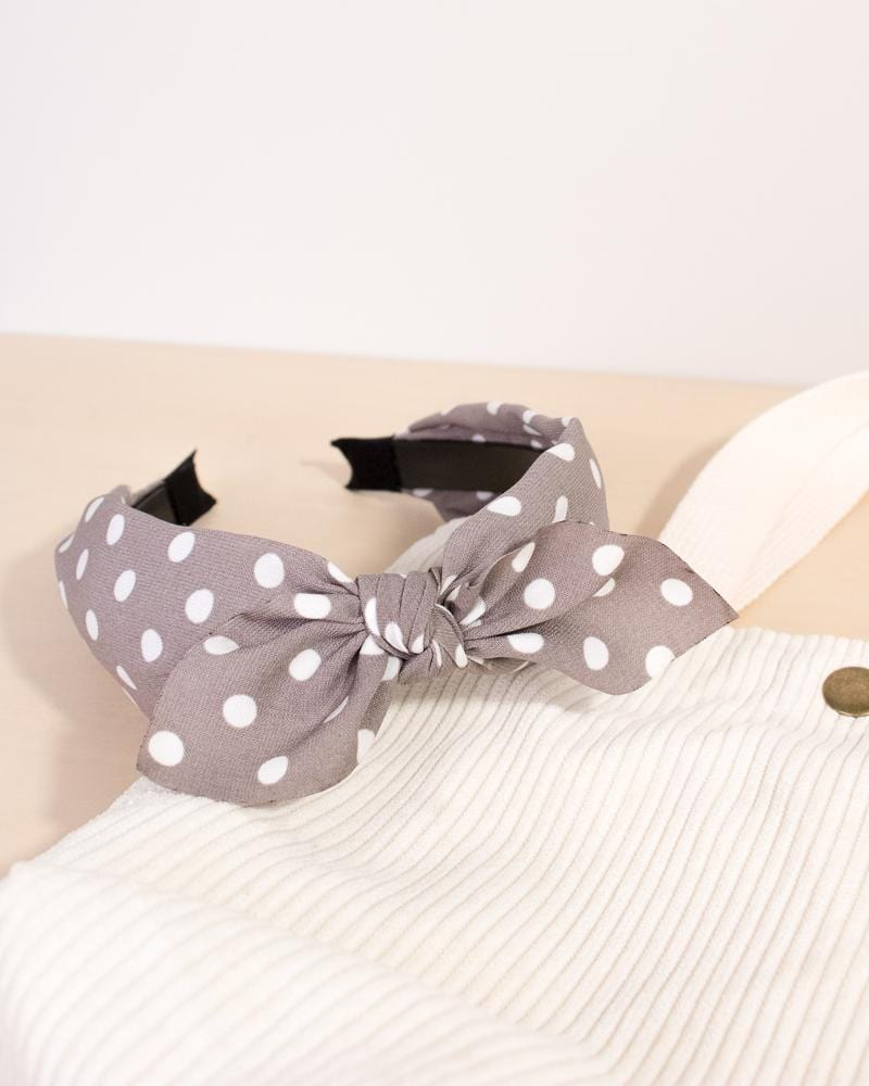 spotted bow headband in light grey colour style, displayed on tote bag