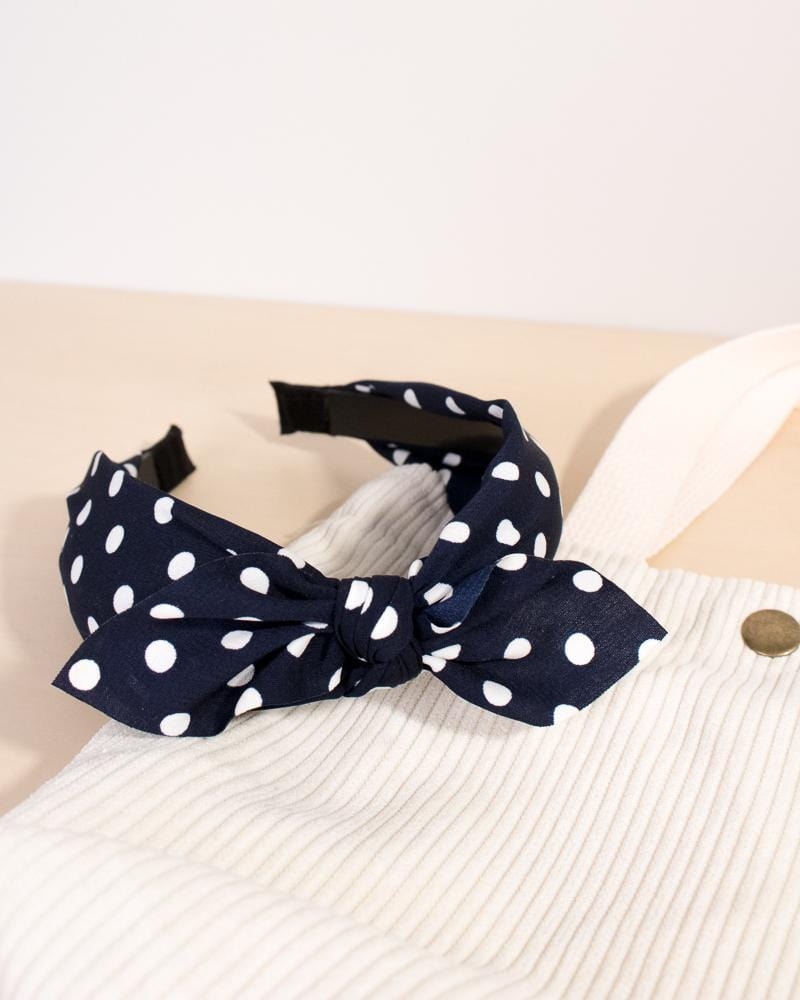 spotted bow headband in marine navy colour style, displayed on tote bag