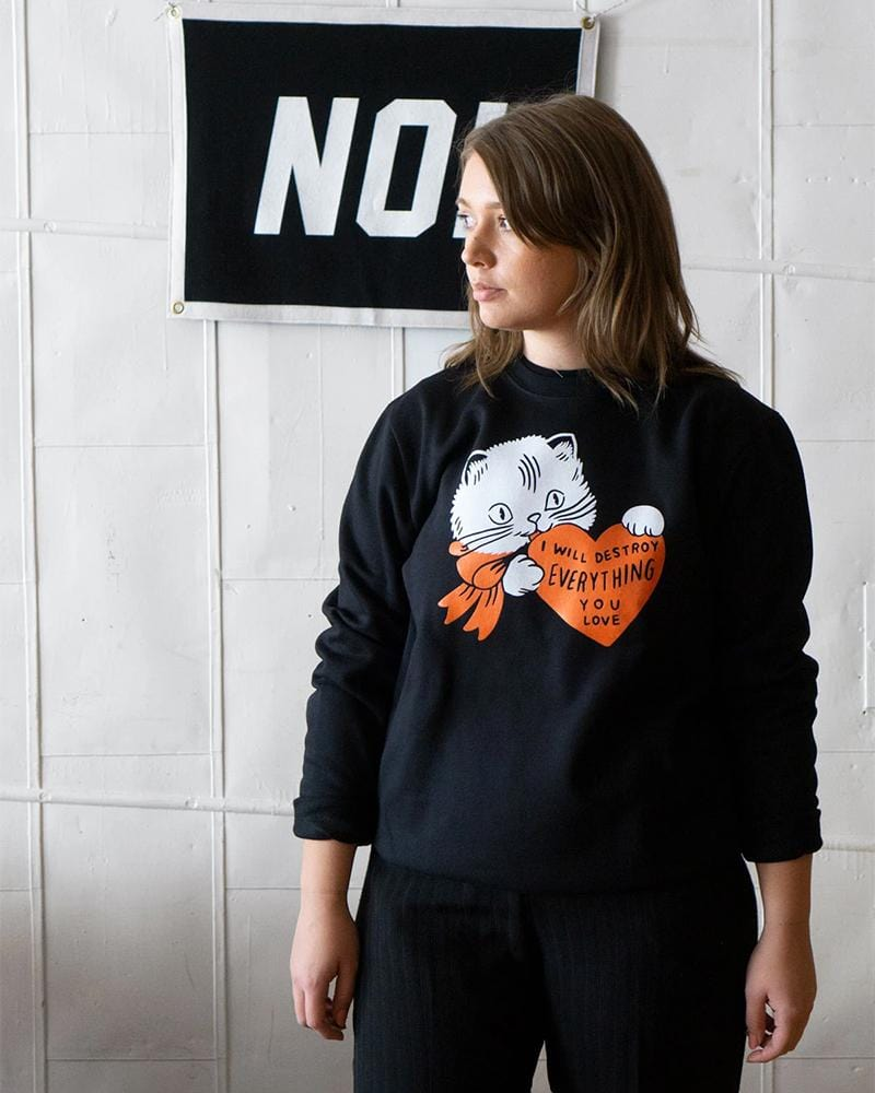 a woman wearing Stay Home Club Destroy Cat Crewneck sweatshirt