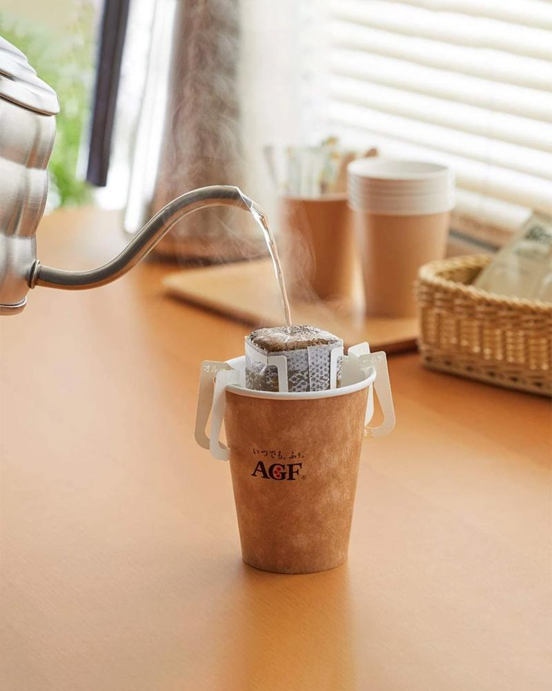 hot water pouring into cup with AGF Blendy Drip Mocha Coffee filter