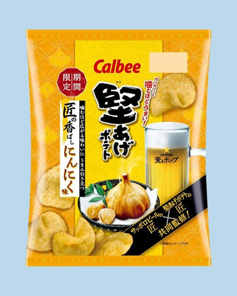 Bag features a whole garlic and beer surrounded by potato chips.