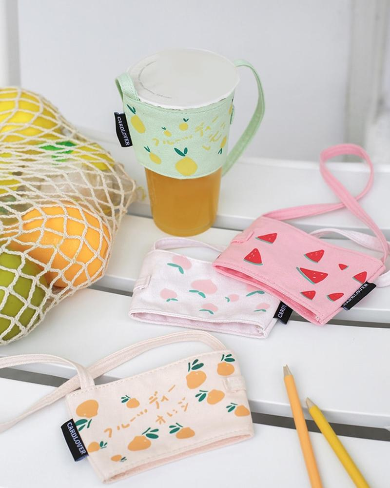cardlover fruity series coffee and bubble milk tea cup holder sleeve displayed with cup along with all 4 styles; lemons, watermelons, peaches and oranges