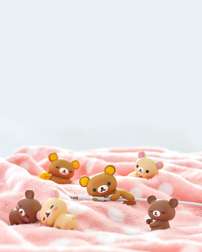 Rilakkuma and friends on a pink blanket.