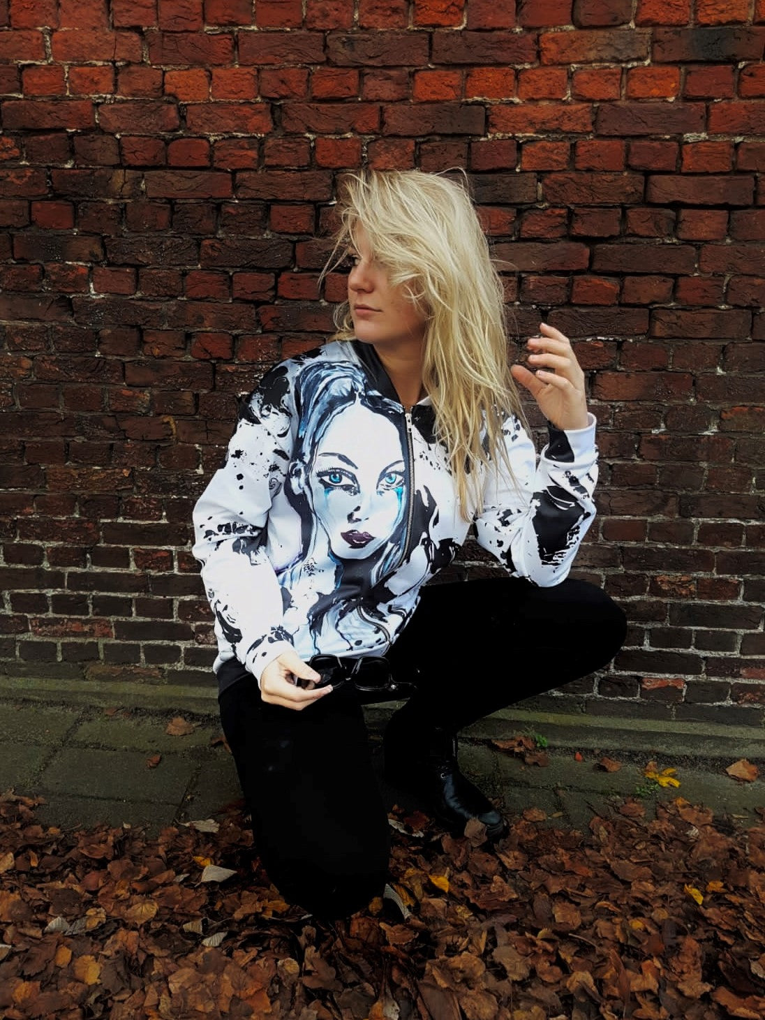 Jacket with an art based portrait of a beautiful lady on the front with zipper and long sleeves and made of polyester