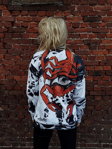 black and white jacket or coat with a big red scorpion on the back by Aphellos brand