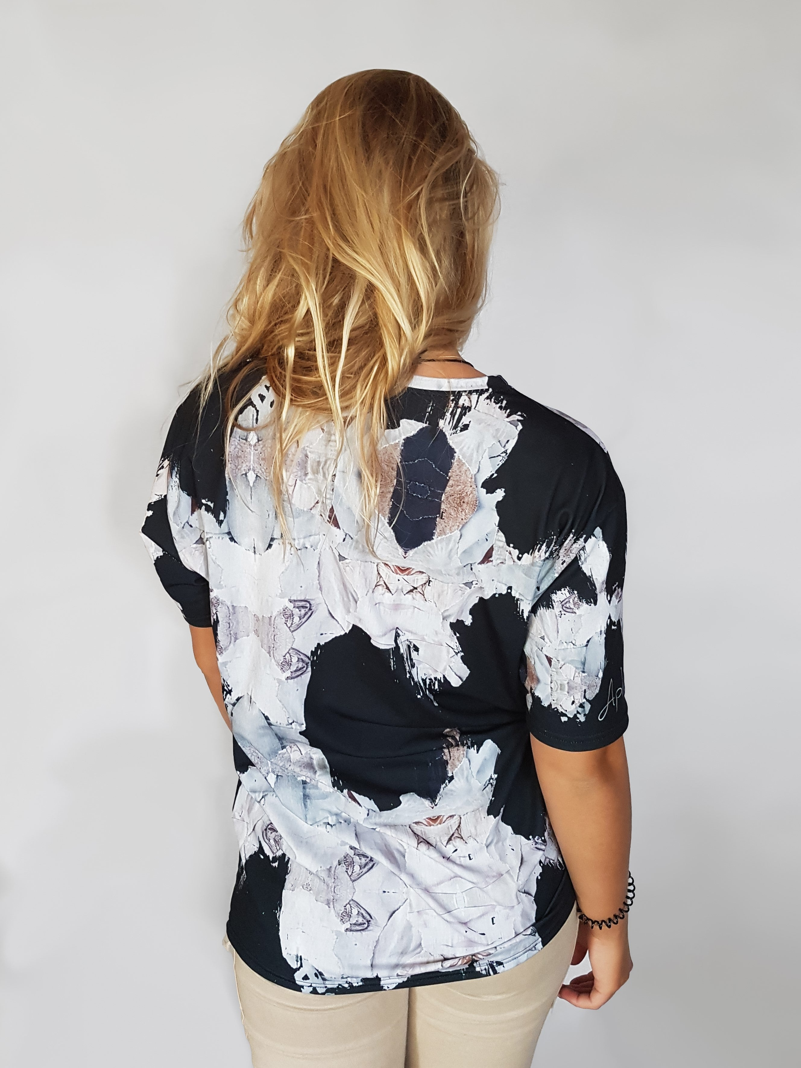 Black Glamour art shirt with paper pieces giving a vintage modern aesthetic backside