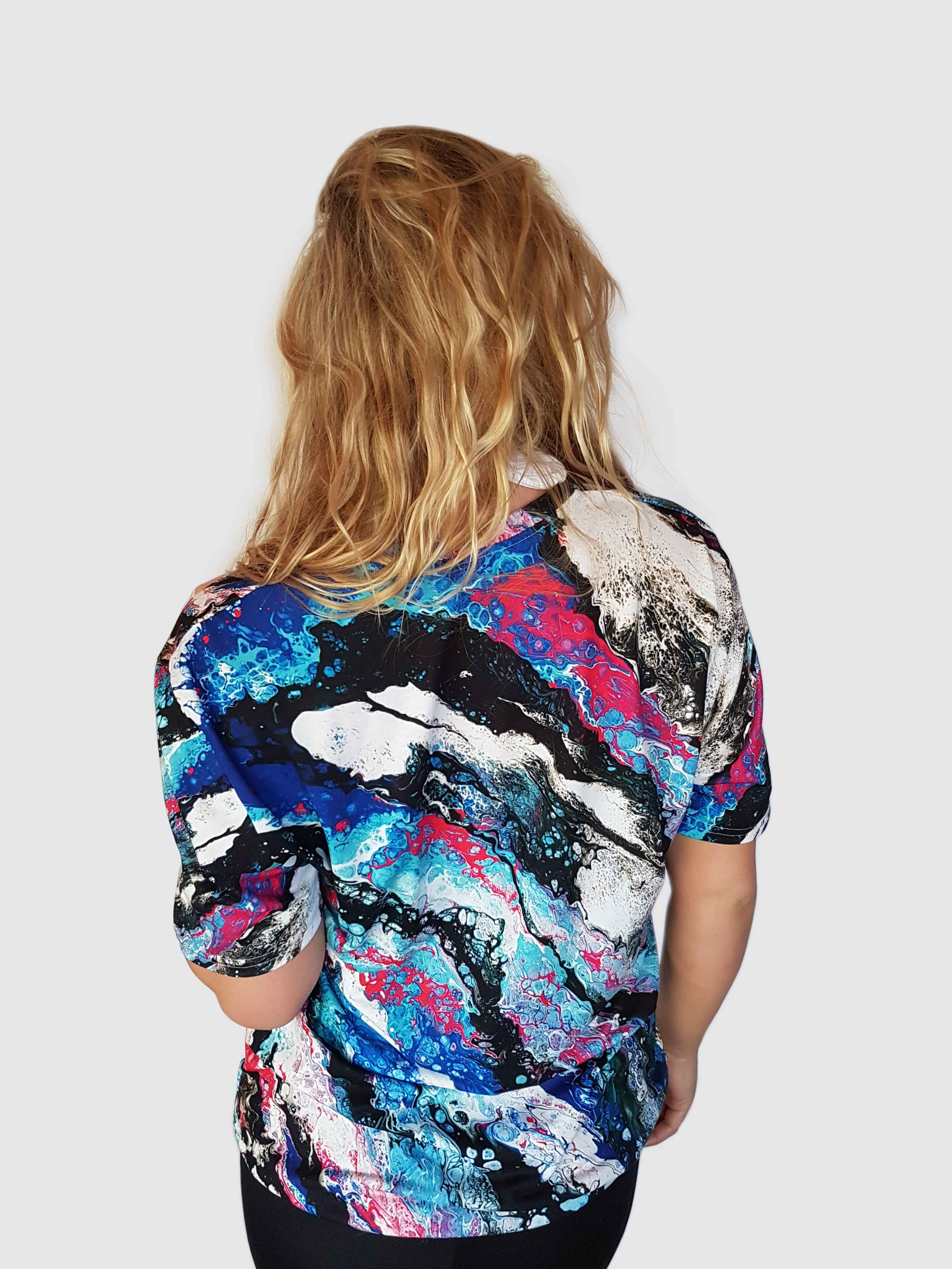 women's blue t-shirt with an aquatic print depicting the ocean or sea