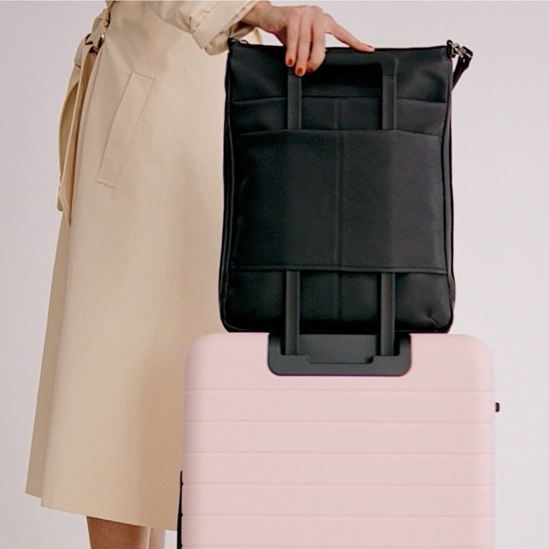 Features a luggage sleeve for easy airport portability, with a French seam detail.