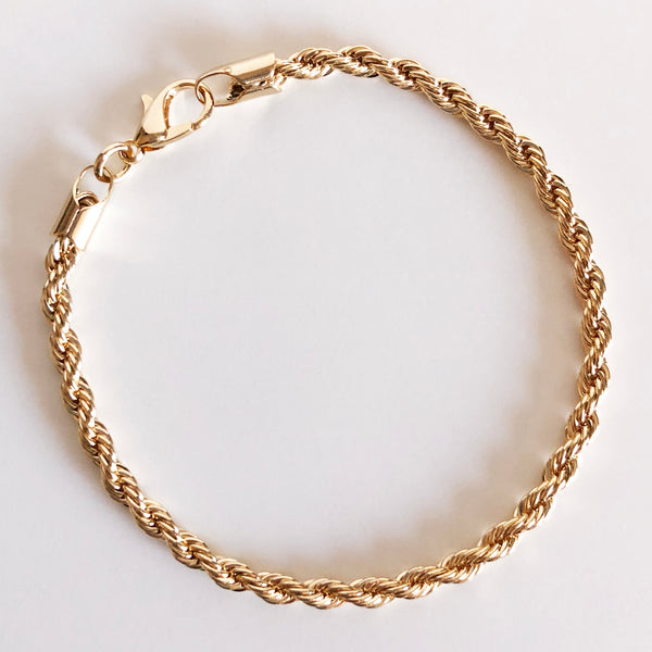 Gold rope chain bracelet flat lay display