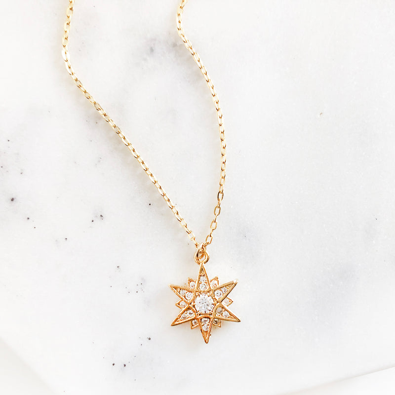 Gold multi-point star charm necklace