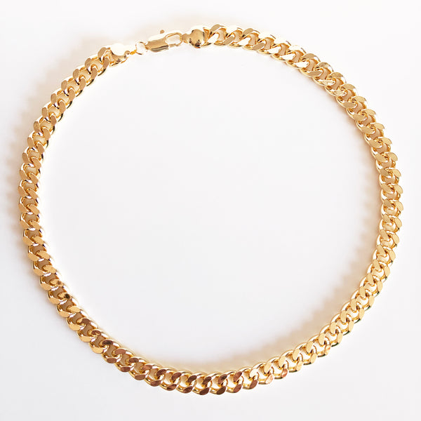 Chunky gold cuban link Anubis chain flat lay display