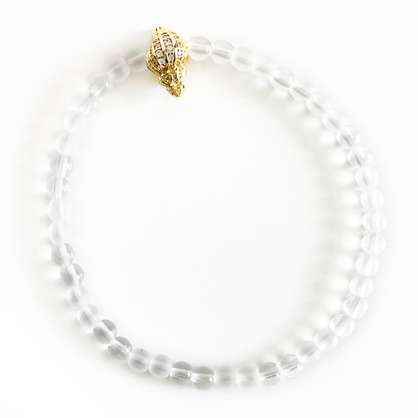 Gloss clear & and matte clear beaded bracelet with gold seashell bead