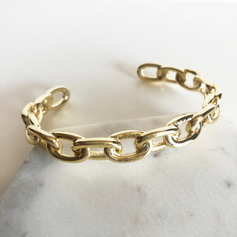 Chunky gold link chain cuff bracelet display