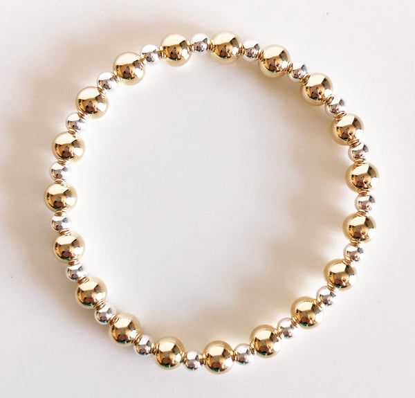6mm gold and 4mm silver alternating beaded bracelet flat lay display