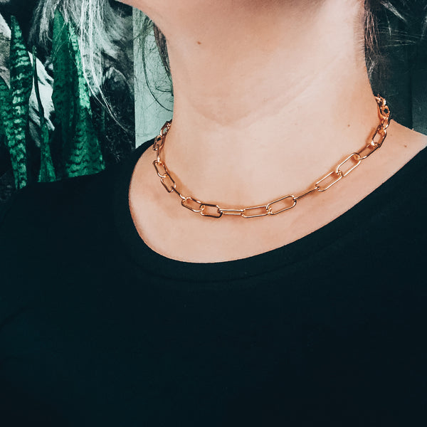 Model photo wearing 14K Gold-Filled thick link chain bracelet with extender