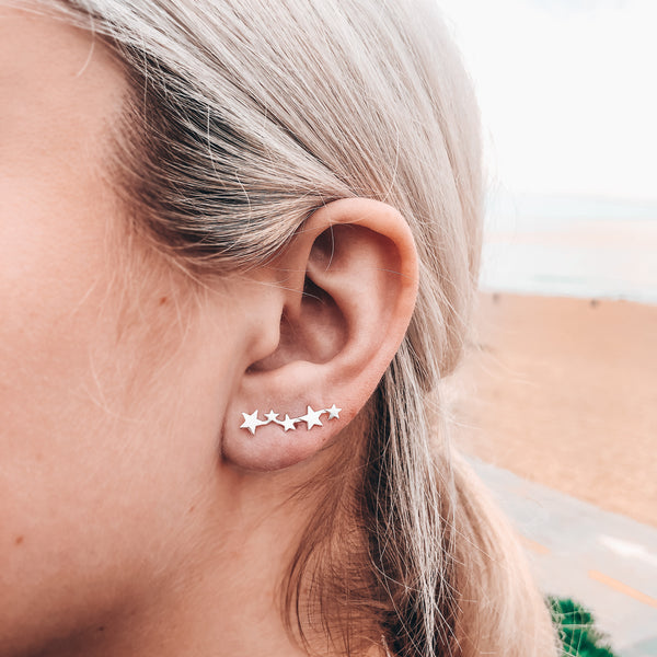 Model photo wearing sterling silver star ear climber