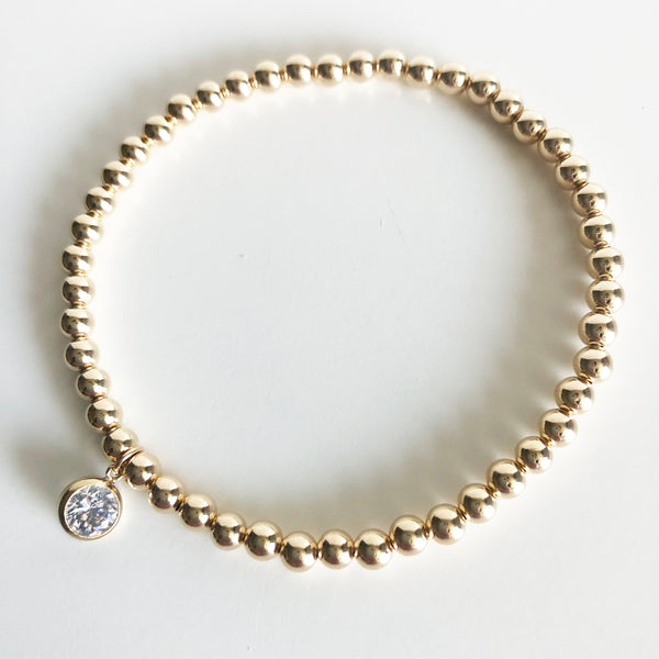 4mm 14K Gold-Filled Beaded Bracelet with a round Swarovski crystal charm