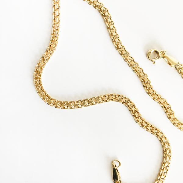 up close detail photo of 14k gold-filled multi-layer thick chain necklace