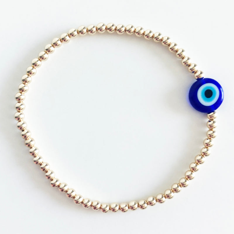 blue evil eye bead on 3mm 14k gold-filled beaded bracelet
