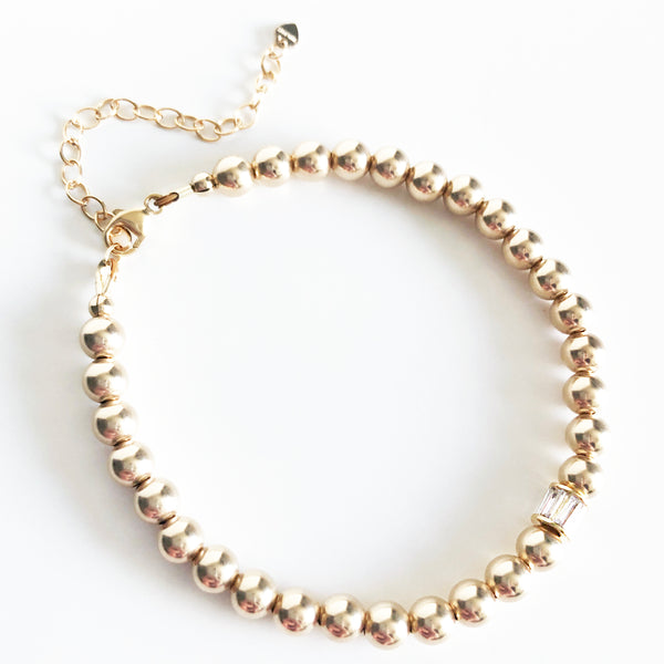 5mm gold beaded bracelet with extender and spinning CZ charm