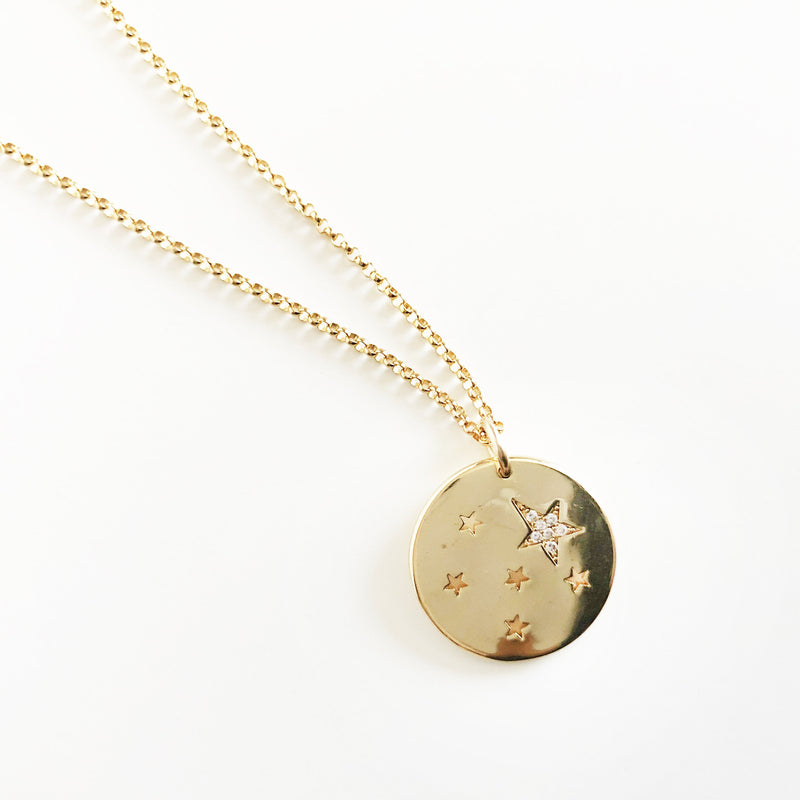 14k gold-filled chain coin necklace with star cutouts and CZ