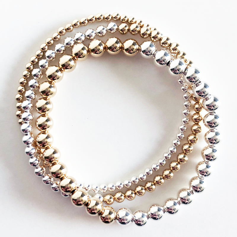 triple stack of half 14k gold-filled and half sterling silver beaded bracelets in 3mm, 4mm, and 6mm bead sizes