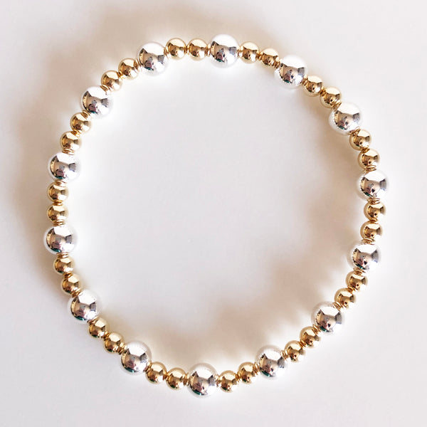 6mm silver and 4mm gold alternating beaded bracelet flat lay display