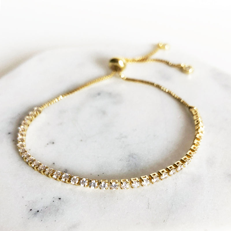 14k gold-filled CZ tennis bracelet with box chain and bolo slider closure up close detail view