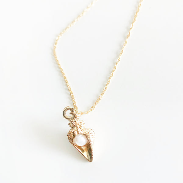 14k gold-filled chain necklace with conch shell charm with pearl in the middle