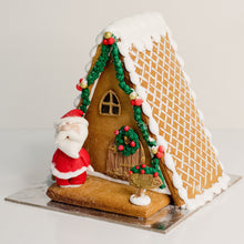 Load image into Gallery viewer, Celebrate Christmas with this stunning gingerbread house. Santa's out the front having a jolly old time. Christmas cakes, Gingerbread houses Brisbane, birthday cakes Brisbane, cakes Brisbane cake shops Brisbane, cupcakes Brisbane, cake shop Brisbane,