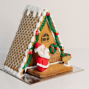 Celebrate Christmas with this stunning gingerbread house. Santa's out the front having a jolly old time. Christmas cakes, Gingerbread houses Brisbane, birthday cakes Brisbane, cakes Brisbane cake shops Brisbane, cupcakes Brisbane, cake shop Brisbane,