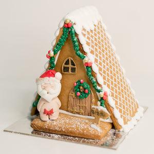 Celebrate Christmas with this fun naughty gingerbread house. Santa's being rather naughty on this one. Christmas cakes, Gingerbread houses Brisbane, birthday cakes Brisbane, cakes Brisbane cake shops Brisbane, cupcakes Brisbane, cake shop Brisbane,