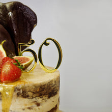 Load image into Gallery viewer, Decadent birthday cake and celebration cakes. This caramel cake tastes amazing and looks beautiful with its semi-naked butter cream icing, chocolate decoration and gold dripping!