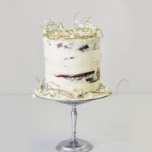 Brisbane's best cake shop. A stunning semi-naked cake with a rustic feel. Entwined vines and sweet tiny flowers perfect for baby showers, birthday and celebration. Verucca's Cakes.