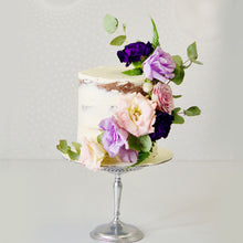 Load image into Gallery viewer, Semi naked cake with front decorations of a fresh flower cascade.