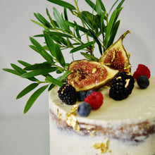 Load image into Gallery viewer, Unfussy cakes. A gorgeous semi-naked cake decorated with foliage, seasonal fruit and a touch of 23k gold leaf - breathtaking! Brisbane cake decorator and designer.