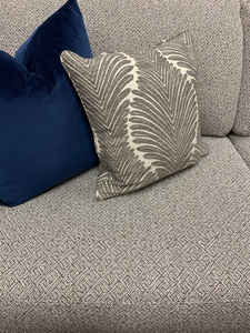 A Gray Geometric Sofa with Pillows