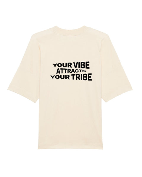 "Back side T-Shirt view with graphic ""Your Vibe Attracts Your Tribe""."
