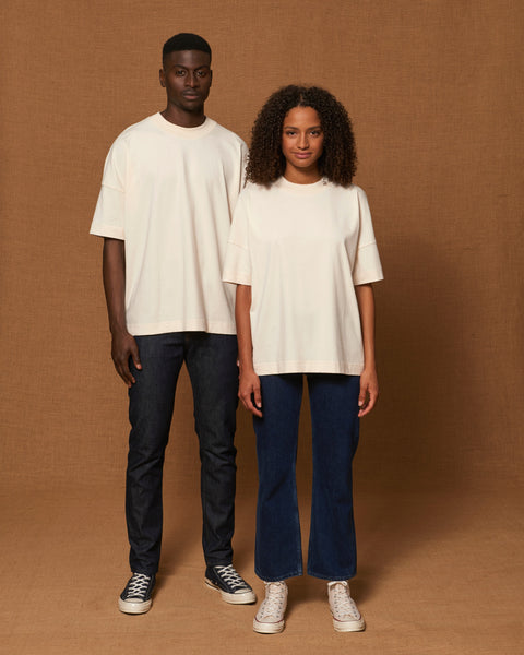 Boy and girl from the front, wearing off-white 100% organic cotton T-Shirts in an oversized look. The front side of the T-Shirt has no graphic.